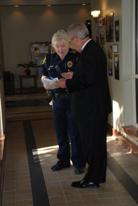 Deputy Constable Smythe serving the Rt. Rev. Jack Iker with the lawsuit