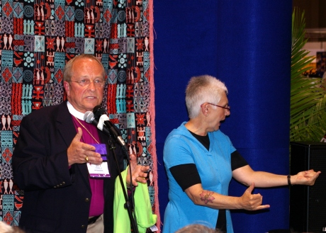 The Rt. Rev. V. Gene Robinson with an ASL interpreter addressing a breakaway group at the 2009 General Convention in Anaheim on July 8, 2009